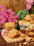 Oatmeal cookies and daisy flowers Royalty Free Stock Photos