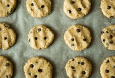 Homemade oatmeal cookieswith chocolate drops prepared to be baked on a baking tray. Royalty Free Stock Photography