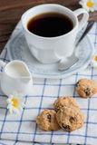 Homemade oatmeal and raisin cookies with a cup of coffee. Stock Photo