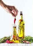 Homemade oil with herbs Royalty Free Stock Images