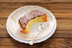 Homemade oldfashioned pie with chololate icing and tea spoon on Royalty Free Stock Photography