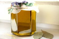 Homemade olive oil. Fresh and healthy homemade olive oil placed in a glass jar Stock Photo