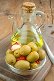 Homemade olive oil on wood Royalty Free Stock Photo