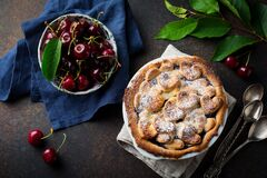 Free Homemade Open Cherry Pie With Lattice On A Dark Concrete Background. Selective Focus. Top View Stock Images - 211067154