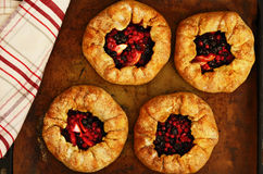 Homemade open pies or galette with apple and berries Royalty Free Stock Photos