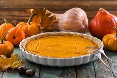 Homemade open pumpkin pie for Thanksgiving dinner served with de Stock Image