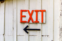 Homemade orange exit sign and arrow Royalty Free Stock Images