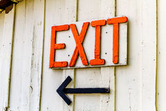 Homemade orange exit sign and arrow Royalty Free Stock Photos