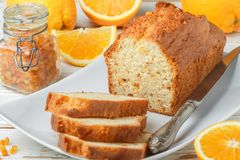 Homemade orange fruit loaf cake with citrus candied fruits and nuts. Traditional treat for tea for Breakfast. Pound cake. Selective focus royalty free stock images