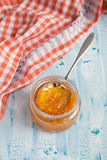 Homemade Orange jam with a spoon. On the wooden table Royalty Free Stock Images