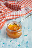Homemade Orange jam with a spoon. On the wooden table Royalty Free Stock Image