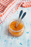 Homemade Orange jam with a spoon Stock Photos