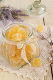 Homemade orange jelly bars in glass jar Royalty Free Stock Photo