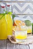 Homemade orange liqueur Stock Photos