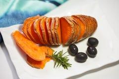 Homemade Orange Sweet Potato with olives and rosemary stock image