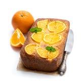 Homemade orange syrup cake isolated on white. Homemade  orange syrup cake isolated on white royalty free stock image