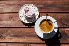 Homemade organic dessert ,made of fruit and berry puree, zephyr or marshmallow with coffee cup isolated. Romantic good Royalty Free Stock Photography