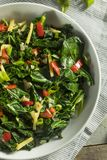 Homemade Organic Green Collard Greens. With Pepper and Ginger Stock Images