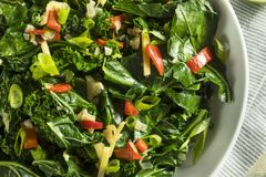 Homemade Organic Green Collard Greens. With Pepper and Ginger Royalty Free Stock Image
