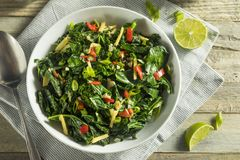 Homemade Organic Green Collard Greens. With Pepper and Ginger royalty free stock photo