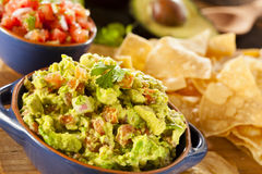 Homemade Organic Guacamole and Tortilla Chips Stock Images