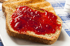 Homemade Organic Red Strawberry Jelly on toast Royalty Free Stock Photography