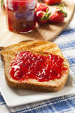 Homemade Organic Red Strawberry Jelly on toast Royalty Free Stock Photos