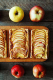 Homemade organic ruddy pies with apples puff pastry, ready to eat. Delicious apple puff on a wooden table, on a rustic wood kitche Royalty Free Stock Photo