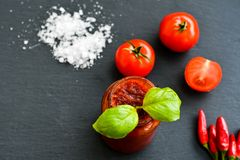Homemade Tomato paste. Homemade  organic Tomato paste  , fresh tomato  ,salt, basil,  red hot chili peppers Stock Photos