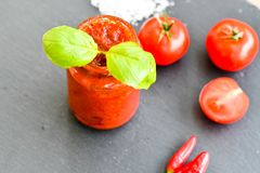 Homemade Tomato paste. Homemade  organic Tomato paste  , fresh tomato  ,salt, basil,  red hot chili peppers Royalty Free Stock Photo