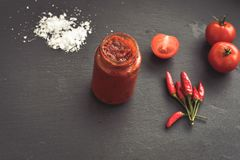 Homemade Tomato paste. Homemade  organic Tomato paste  , fresh tomato  ,salt, basil,  red hot chili peppers Royalty Free Stock Image