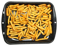 Homemade Oven Baked Crinkle Fries in Pan Royalty Free Stock Image