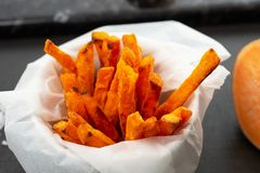 Oven Baked Sweet Potato Fries. Homemade oven baked sweet and juicy, sweet potato fries. Gluten free, vegan, vegetarian royalty free stock photos
