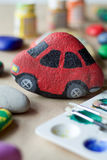 Homemade painted stone as  red toy car Royalty Free Stock Photos