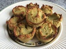 Homemade paleo avocado bread mini cupcakes. Homemade paleo avocado bread cupcakes on wedgwood plate Royalty Free Stock Photos
