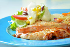 Homemade pan fried pork steak with mix vegetable salad Stock Photos