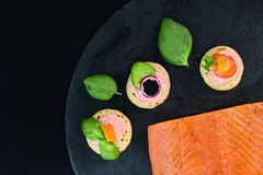 Homemade pancake canapes and piece of smoked salmon Royalty Free Stock Photos