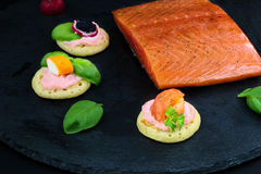 Homemade pancake canapes and piece of smoked salmon Royalty Free Stock Image