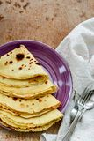 Pancakes. Homemade pancake crepe     with    blueberry jam and ices sugar on b wooden background Royalty Free Stock Photo