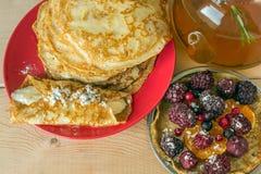 Homemade pancakes with banana, berries and walnuts. Royalty Free Stock Photo