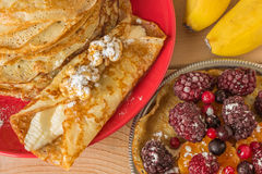 Homemade pancakes with banana, berries and walnuts. Stock Photography