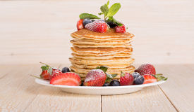 Homemade pancakes with berries and fruit Royalty Free Stock Images