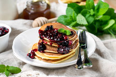 Homemade pancakes with berry sauce coulis and mint Royalty Free Stock Image
