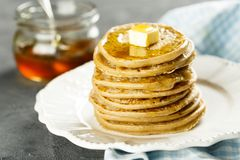 Homemade pancakes with butter and honey. Homemade buckwheat pancakes with butter and organic honey Royalty Free Stock Photos
