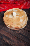 Homemade pancakes with butter on wood, closeup Stock Image