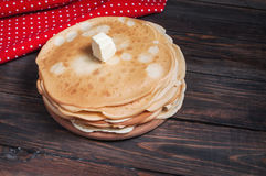Homemade pancakes with butter on wood, closeup Royalty Free Stock Image