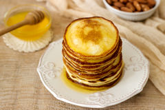 Homemade pancakes with honey and nuts, breakfast. Royalty Free Stock Image