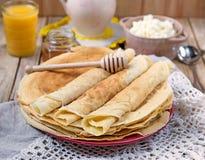 Homemade pancakes with honey and orange juice Stock Photos