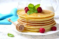 Homemade pancakes with honey and raspberry. stock photo