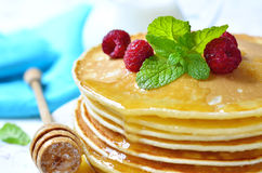Homemade pancakes with honey and raspberry. royalty free stock photography